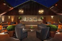 The event's design felt modern and architectural, with structured seating in rich upholstery.