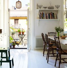 Love the idea of a dining room with a door outside. Keeps the stuffiness to a minimum and really makes eating central to the house (:
