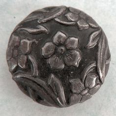 Vintage domed, floral, tinted white metal button