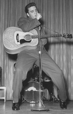 Elvis pictured with his iconic '55 D28 Martin guitar. Played one, fell in love with it, summer job doesn't pay enough for me to buy it. One day!!