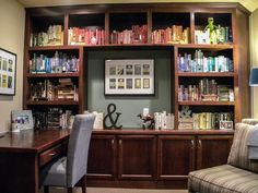 A great way to fill up the height of the bookshelves by stacking books under, then over them. Love the color order, too, it looks like fabric!