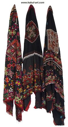 Kohistani Shawl Woman's head covering of heavy black cotton, embroidered in silk with geometrical and floral motifs and further embelished with glass beads and zipper parts. Usually a part of an ensemble that includes likewise pants and dress, it all adds up to quite a burdon to carry.