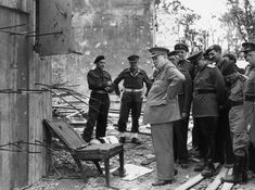 English politician and Prime Minister Winston Churchill inspecting a chair once used by Adolf Hitler during a tour of the ruins of the Chancellory in Berlin with a group of Allied officers. Winston Churchill, Iconic Photos, Rare Photos, Berlin, Kaiser Wilhelm, British Prime Ministers, Draw On Photos, Army & Navy, Historical Fiction
