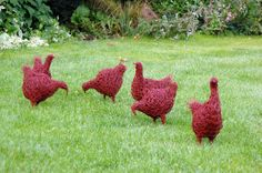 Densely packed chicken wire chickens, painted