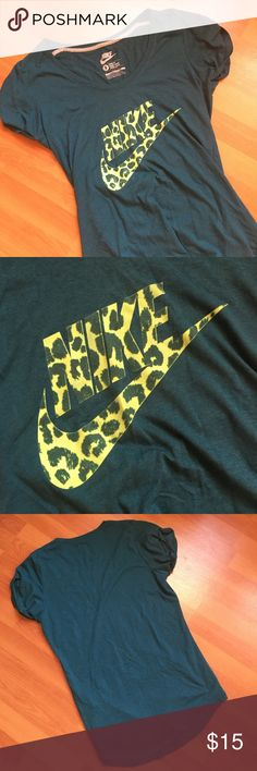 Green Nike tee velvety Cheetah lettering Small Loose fitting Nike tee, a gorgeous dark green color. The block lettering sporty Nike name and swoosh are actually a velvet material with a funky cheetah print design on it. No flaws! Nike Tops Tees - Short Sleeve