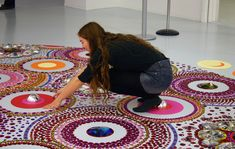 suzan drummen's large-scale floor installations are  fractal-like arrangements featuring ornate and elaborate circles of mirrors and brightly colored glass.