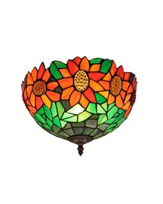 Inspired by the famous design of Louis Comfort Tiffany, this flush mount ceiling light offers impressive craftsmanship featuring multicolored art glass shade with sunflower motif. This fascinating ceiling light will not only light up your living space, but also add a touch of cheerfulness and vibrancy to your home decor.