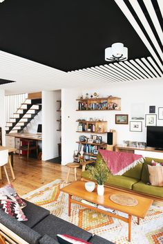 Eclectic Family Room by Nest Architects / Wow, the black ceiling makes the height feel infinite.