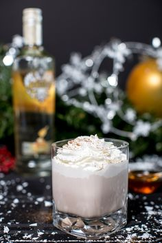 Nutty Honey Love with 1 oz Smirnoff® Wild Honey Flavored Vodka, 0.5 oz hazelnut liqueur, 0.5 oz creme de cacao, 1 oz cream, and whipped cream. Add ingredients to an ice-filled shaker. Shake and strain into a martini glass. Garnish with grated nutmeg and whipped cream. #Smirnoff #drink #recipe #whippedcream