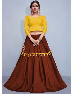 Copper brown and mustard yellow lehenga choli set. The lehenga comes as stitched in Size and can be extended up to Size To complete the look matching choli is available with th Cotton Lehenga, Red Lehenga, Party Wear Lehenga, Yellow Lehenga, Lehenga Blouse, Silk Dupatta, Bridal Lehenga Online, Designer Bridal Lehenga, Bridal Lehenga Choli