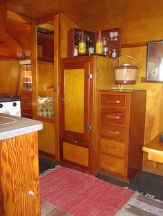 Vintage trailer interior. OMG, look at all that beautiful wood.