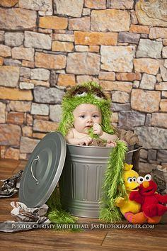 We love this Oscar the Grouch setup from Sesame Street! We also have other characters like Cookie Monster and Elmo.   Christy Whitehead photography. Jacksonville, Florida based wedding, engagement, newborn, maternity and family photographer. Destination weddings.