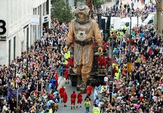 The Giant Uncle makes his way down Castle Street, Liverpool, to meet the Lord Mayor on his pursuit to find his niece, as part of Sea Odyssey, a love story based around the sinking of the Titanic. The day the giants came!