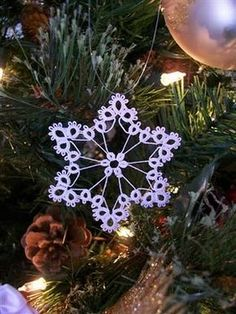 Honey Bee's Bliss: Tatted Snowflake: Ornament 3--I wanted to learn how to tatt but not successful yet.