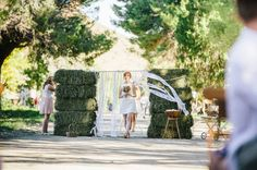 ribbon door entrance with hay bales ~ thought this was cute