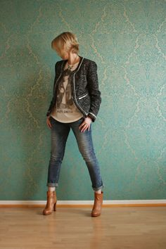She just looks cool. I like the idea of a punk rock tee with a semi-casual jacket.  (only if I like the band, of course--don't want to be a poser!) I love rolling up my jeans with booties. I might be able to pull off this high of a heel. I could take or leave the necklace.