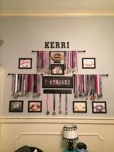 Gymnast medals and score sheets display using curtain rods sports wall Trophy Display, Award Display, Display Medals, Trophy Shelf, Display Wall, Race Medal Displays, Gymnastics Room, Soccer Room, Gymnastics Medal Holder