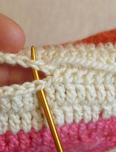To whip stitch, I brought the needle under both strands of the edge stitches. Instead of turning the needle around to come back the other way, I pushed my needle through in the same direction for every stitch.