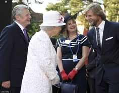 The Queen was introduced to actor Henning Baum, right, who appears on one of Germany's favourite TV shows The Last Cop
