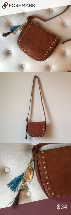 Studded Saddle Bag Magnetic closure. Fabric lining. From a smoke-free, pet-free home. Price is firm unless bundled. No trades. I follow all Poshmark rules. Bags
