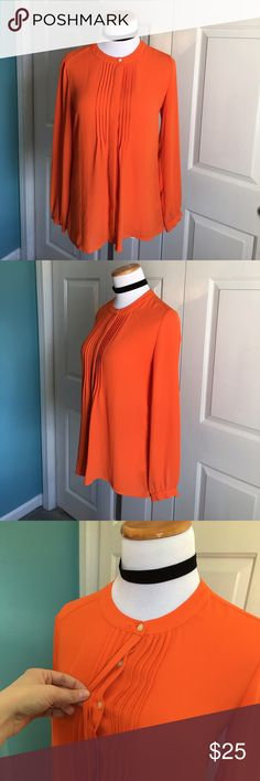 Banana Republic Blouse Orange hidden button blouse. Small pen mark on bottom of sleeve. Very small, about the length of a dime. Open to reasonable offers. Size XS, but fits like a small in my opinion. I'm a 4/6 and this fits fine. Banana Republic Tops Blouses