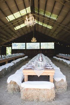 Fun barn wedding with haybale seating