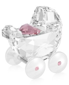 Give the newest member of your family a hearty welcome. Clear crystal beautifully contrasts with light pink crystal accents, including a heart-shaped pillow at the center of this collectible figurine.