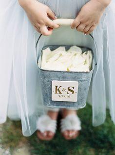 Customized flower girl metal bucket, cream petals, light blue tulle skirt // Photography by Verdi