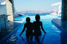 Girls in Santorini-Astarte Suites infinity pool on KatCaprice.com