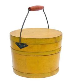 """Lot 11: Lidded Pail. Estimate: $1,200 – $1,800. Price Realized: $4,012. Pine, original chrome yellow painted finish with light varnish, original light blue painted interior, heavy wire bail with fitted and turned bail handle in birch with original red stain, clipped diamond bail plates (to accommodate the lid) fastened with copper rivets, in original black paint, stamped """"26"""" on bottom and under lid, dated in pencil on bottom """"Sept 1850″, two securing iron hoops with two rivets and clipped…"""