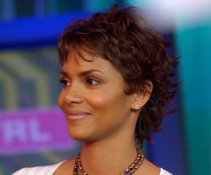 Halle Berry: In this older photo, Halle's short-on-top but longer-in-the-back style gives the illusion of length. Her natural texture lends some playful character.