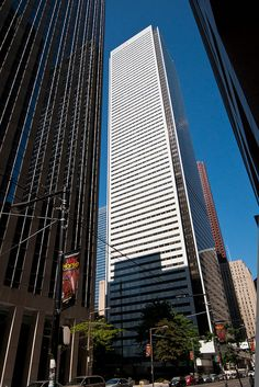 """The tallest office building in Canada, First Canadian Place is completing a massive """"revitalization"""" project. The exterior cladding of discoloured white marble was replaced with gleaming white fritted glass."""