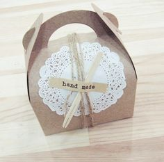 Handmade packaging with paper doily and wooden spoon etc