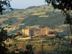 Castello Montepo as viewed from Scansano. Rent a car, get on a bike - and simply wonder around. You'll be amazing at what you see on every bend.  Scansano, Tuscany