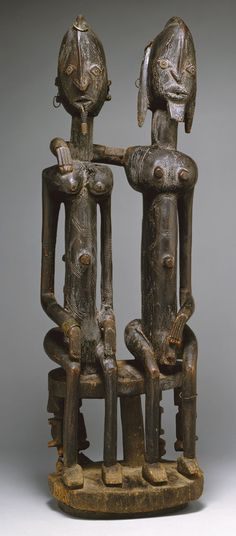 Africa | Seated Couple. Dogon culture ~ Mali | ca. 16th - 19th century | Wood and metal