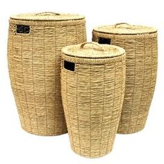 Set of three round seagrass laundry baskets.      Product: Small, medium and large basket  Construction Material: Sea grass  Color: Beige