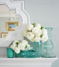 blue glass vases, big and small, and how to display them. Love them on the mantle