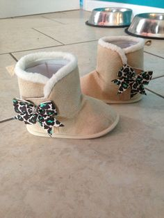 Baby ugg boots with bows  by TopNotchPartySupply on Etsy, $15.00