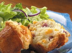 Ham and Cheese Muffins...Bursting with creamy melted cheese and ham, these big hearty muffins make a great stand-alone breakfast, or serve them with soup or salad for lunch.