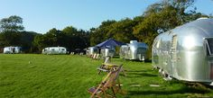 A field full of gleaming airstreams, varied yet entirely authentic, in a peaceful spot with a laid-back vibe