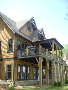 Lake Martin, Alabama lake home - Designed by Mitch Ginn - beautiful cedar shakes and battered stone - gable trusses and brackets www.mitchginn.com