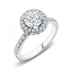 This beautiful engagement ring was inspired by the rich history and power of old Spain. Worthy of royalty, we set a stunning round cut diamond at this ring's center and made it the focal point to the overall design. To help attract the eye and to accentua Round Cut Diamond, Halo Diamond, Round Diamonds, Diamond Rings, Diamond Engagement Rings, Beautiful Engagement Rings, Swarovski, Sterling Silver, Spain