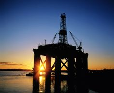 North sea oil and gas platform at sunset