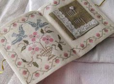 lovely cross stitch needle keeper                                                                                                                                                                                 More