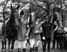 British Equestrian team in Stockholm Stadium, Sweden, June 14, 1956, after winning the Olympic Games Three-Day Eventing Gold Medal. Arthur L. Rook on 'Wild Venture', left, Albert E. Hill on 'Countryman III', centre, and Colonel Frank Weldon on 'Kilbarry'.