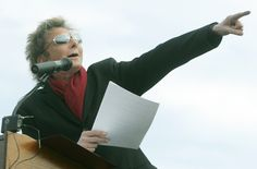 """Barry Manilow yells out """"Move that bus"""" as he instructs his moving vans to deliver musical instruments to Joplin schools during Thursday's event at Junge Stadium. 10-27-11"""