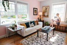 pink wall - who would of thought a pink wall would be so crisp yet warm and inviting...paired with a cool grayish-bluish wall...i like this!