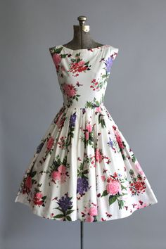 Vintage 1950s Floral Dress - Bridesmaids in pink floral (maybe a  busier pattern than this one) with solid ribbons around their waist, with pink shoes. I could possibly where matching pink shoes.