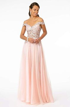 Step out in style wearing this stunning gown by Elizabeth K GL2953. Makes a statement in a sleeveless, off-shoulder neckline with an embroidered bodice. It has a back zipper closure and flourishes a full length A-line skirt. Orchestrate a spectacular evening of dazzling sophistication in this luxurious Elizabeth K gown. #FormalDresses #elegantdresses#eveningdresses