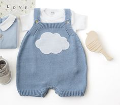 Knitted overalls in sky blue with a cloud. 100% cotton. READY TO SHIP size…